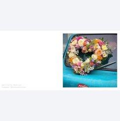 Hjärtkrans av blommor by Sara Thott